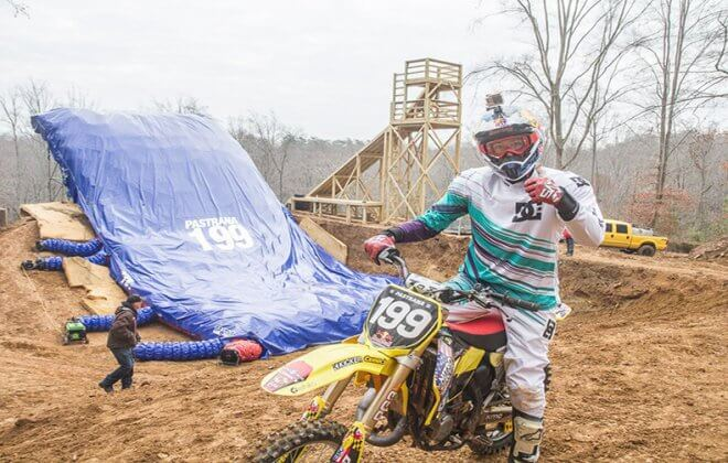 Travis Pastrana in front of his Bagjump landing airbag