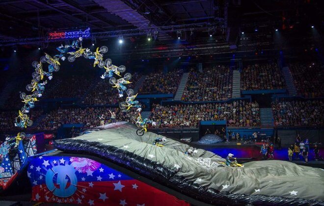 FMX backflip on a bagjump landing airbag at Nitro Circus